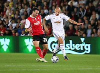 Pictured:  Jonjo Shelvey of Swansea of Swansea (R) against Craig Morgan of Rotherham (L). Tuesday 26 August 2014<br /> Re: Capital One Cup, Swansea City FC v Rotherham at the Liberty Stadium, south Wales
