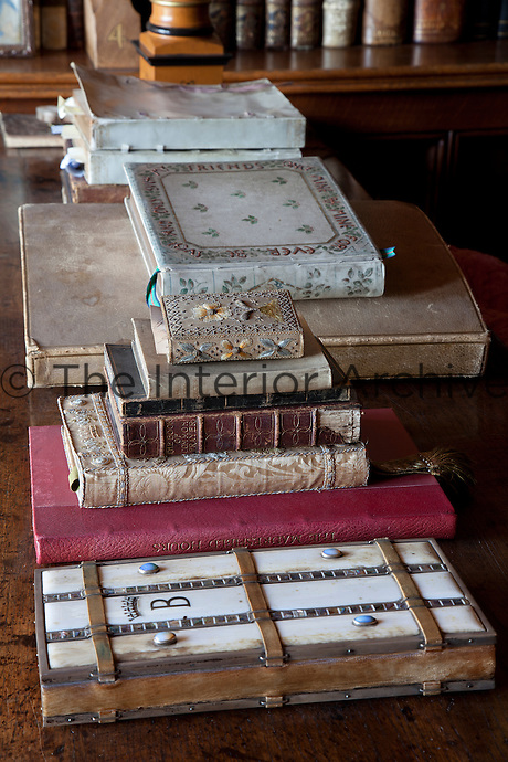 The library at Madresfield Court contains many precious volumes in its collection of some 8000 books, some of which date back to before the invention of printing