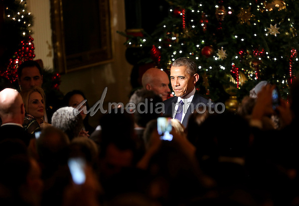 United States President Barack Obama greets people at the end of the second Hanukkah reception of the day in the East Room of the White House, December 14, 2016, Washington, DC. Photo Credit: Aude Guerrucci/CNP/AdMedia