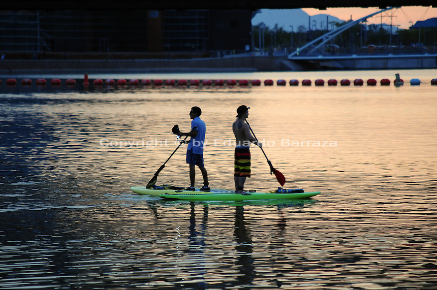 Tempe, Arizona. Two young men kayaking on Tempe Town Lake at sunset on a summer afternoon. Photo by Eduardo Barraza © 2015