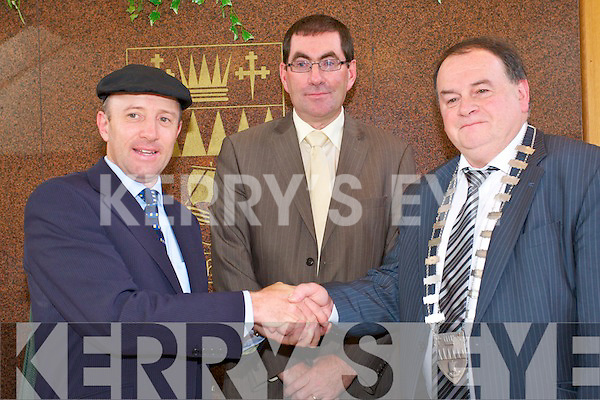 CHANGE: Outgoing mayor of Kerry, Michael Healy-Rae handing over the chain of office to the.newly elected mayor of Kerry, Tom Fleming, with County Manager Tom Curran at back in the Kerry County Council Chambers on Wednesday.