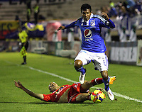 TUNJA -COLOMBIA, 4-OCTUBRE-2014. <br /> Luis Mosquera (Der) de Millonarios  disputa el balon con Ivan Corredor  (Izq) de Patriotas FC  durante partido por la fecha 13 de la Liga Postobón II 2014 jugado en el estadio La Independencia  de la ciudad de Tunja./ Luis Mosquera  (R) player of Millonarios fights for the ball with Ivan Corredor (L) player of Patriotas FC  during the match for the 13th date of the Postobon League II 2014 played at La Independencia stadium in Tunja city<br /> .Photo / VizzorImage / Felipe Caicedo / Staff