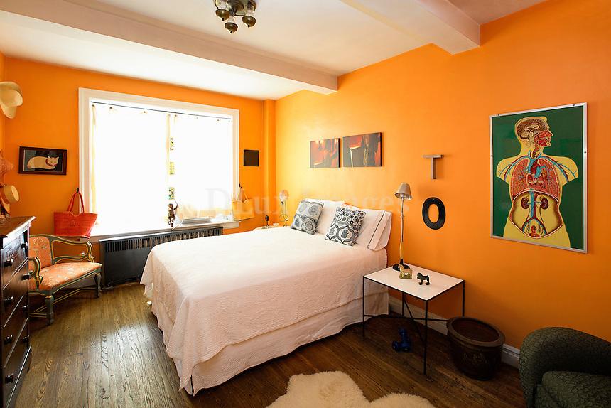 Orange walls in contemporary bedroom