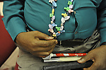 "Closeup of John Gardner, a vision impaired photographer,  wearing necklace he made, at Artist Reception for Seeing with Photography Collective SWPC, a group of visually impaired, sighted and totally blind photographers based in NYC, on Saturday, April 28, 2012, at African American Museum, Hempstead, New York, USA, and hosted by Long Island Center of Photography. Aperture published the group's ""Shooting Blind: Photographs by the Visually Impaired"" in 2005."