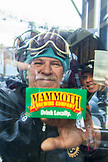 USA, California, Mammoth, a man points from inside the lodge to a Mammoth sticker
