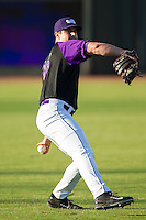 Winston-Salem Dash starting pitcher Carlos Rodon (26) warms up in the outfield prior to the game against the Lynchburg Hillcats at BB&T Ballpark on August 13, 2014 in Winston-Salem, North Carolina.  The Hillcats defeated the Dash 4-3.   (Brian Westerholt/Four Seam Images)