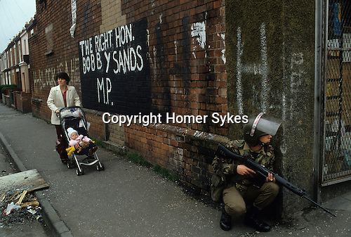 The Troubles armed British soldiers patrol street in Belfast,Northern Ireland Uk 1981