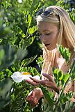 USA, California, Big Sur, Esalen, admiring the flowers in the Buddha Garden, the Esalen Institute