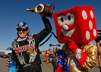 Apr 9, 2006; Las Vegas, NV, USA; NHRA Top Fuel driver Melanie Troxel, right, driver of the Skull Gear/Torco Race Fuels dragster celebrates after defeating David Grubnic in the final round at the SummitRacing.com Nationals at Las Vegas Motor Speedway in Las Vegas, NV. With the win Troxel stretched her points lead in NHRA's top class. Mandatory Credit: Mark J. Rebilas