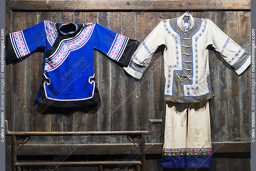 Chinese ancient peasant clothing on a wall at a rural history museum in China
