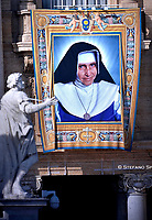 tapestry portraying Dulce Lopes Pontes, hangs from the facade of St. Peter's Basilica, at the Vatican. Pope Francis during  Canonization Mass for English John Henry Newman, Italian Giuseppina Vannini, Indian Maria Teresa Chiramel Mankidiyan, Brazilian Dulce Lopes Pontes, and Swiss Margarita Bays on October 13, 2019 In Saint Peter's square at the Vatican.