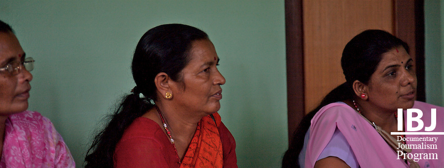 Three women from Nawalparasi District look on as Ram Kumar Bhandari discusses the logistics of forming a committee to speak out for victims' and family rights in the district. A meeting to form a local level committee of families of disappeared people, Nawalparasi Nepal