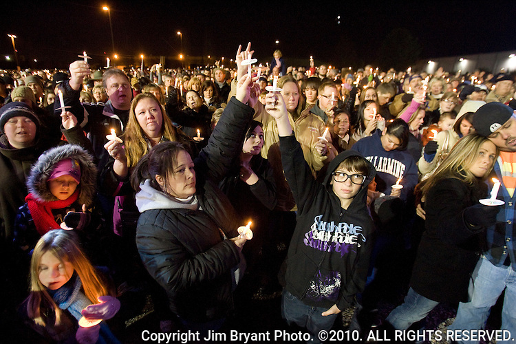 Mourners hold their candles high at the Lakewood YMCA tonight where a candlelight vigil was held for the four Lakewood officers who were slain Sunday in Lakewood, Washington, USA, on 2 December  2009. Afterwards the crowd walked to where a makeshift memorial of flowers, balloons, cards, pictures, toys wreaths were left  at the Police Headquarters for the four Lakewood officers, who, were gunned down during a morning meeting at a local coffee shop on 29 November 2009.   Jim Bryant Photo. ©2010. ALL RIGHTS RESERVED.