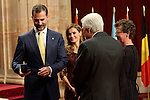 Spain's Crown Prince Felipe (L) and Princess Letizia give a medal to German President of the CERN Rolf Heuer, one of the laureates of the 2013 Prince of Asturias Award for Technical and Scientific Research, during an official audience at the Reconquista Hotel in Oviedo, Spain. October 25, 2013..(ALTERPHOTOS/Victor Blanco)