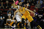 Wyoming's Larry Nance (22) drives around Northern Iowa's Jeremy Morgan (20) 2015 NCAA Division I Men's Basketball Championship March 20, 2015 at the Key Arena in Seattle, Washington.   Northern Iowa beat Wyoming 71 to 54.   ©2015.  Jim Bryant Photo. All Rights Reserved.