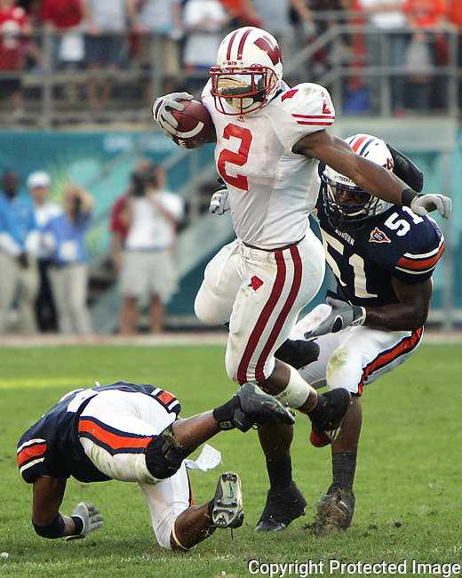 Wisconsin running back Brian Calhoun (2) runs the ball past the Auburn defense in the second half of the Capital One Bowl football game in Orlando, Fla., Monday, Jan. 2, 2006.  Wisconsin went on to a 24-10 vicotory over the Auburn Tigers.(AP Photo/Brian Myrick)
