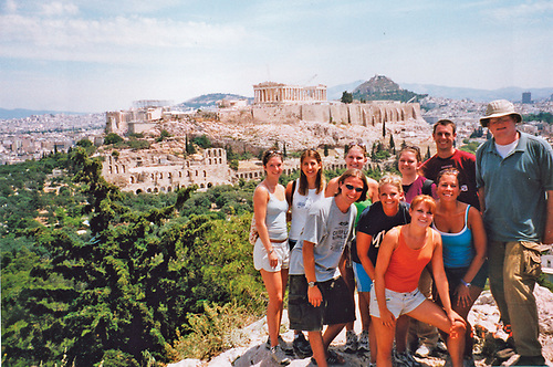 7 girls and 3 guys up high (mountain) above some sort of ancient ruin. Part of study abroad in Greece.