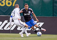 David Beckham (23) defends Ramiro Corrales (12). San Jose 0, Los Angeles 3, McAfee Coliseum, Oakland, California, Saturday, June 14, 2008.