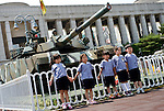 Korean children stand by a tank in the grounds of the National War Museum in  Seoul, South Korea on 23 June, 2010..Photographer: Rob Gilhooly .