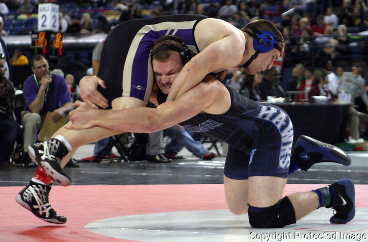 Hockinson's 220 pounder Cameron Loos takes down Sequim's Michael Latimer to earn two points on Friday, Feb, 19, 2016 at the Mat Classic XXVIII held in the Tacoma Dome. Loos went onto win his match 5-3. (Jim Bryant Photo)