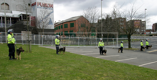 Police dogs, with handler clad in public order uniform, wait to be called outside the EDL rally area in a Dudley car park.