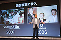 Chairman and CEO Masayoshi Son presents the first quarter earnings (April-June 2015) for SoftBank Group Corp. at the Prince Hotel in Tokyo, Japan, August 6, 2015. SoftBank Group reported a rise in operating profits to 343.6 billion yen ($2.75 billion) from 319.4 billion a year ago. Mr. Son said net profit rose to 213.38 billion ($1.71 billion) nearly triple the 77.57 billion reported a year earlier. This is the first time that Son has shared microphones with a robot to report earnings. (Photo by Rodrigo Reyes Marin/AFLO)