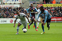 Sunday, 26 April 2014<br /> Pictured: Wayne Routledge (L) of Swansea against Ryan Bertrand of Aston Villa (R).<br /> Re: Barclay's Premier League, Swansea City FC v Aston Villa at the Liberty Stadium, south Wales.
