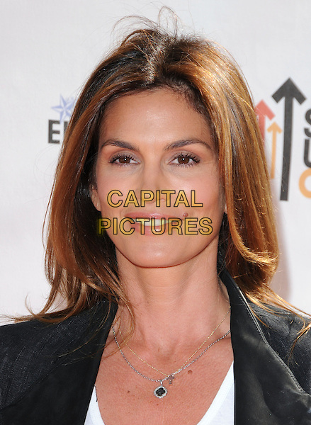 CINDY CRAWFORD .at Stand Up to Cancer held at Sony Picture Studios in Culver City, California, USA, September 10th 2010.     .portrait headshot  white black necklace                                                                  .CAP/RKE/DVS.©DVS/RockinExposures/Capital Pictures.