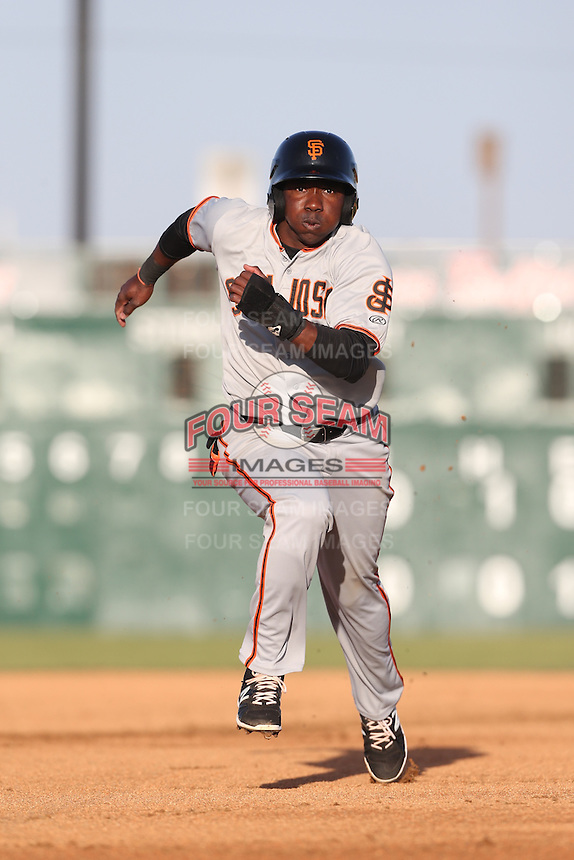 Jesus Galindo (12) of the San Jose Giants runs the bases during a game against the Lancaster JetHawks at The Hanger on April 11, 2015 in Lancaster, California. San Jose defeated Lancaster, 8-3. (Larry Goren/Four Seam Images)