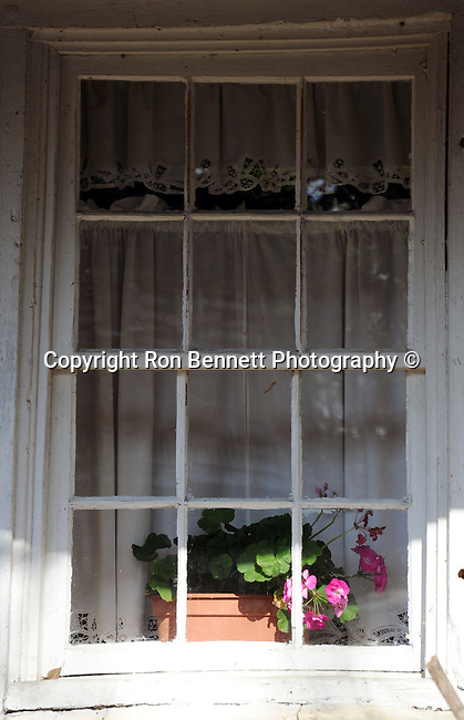 """window with flowers Waterford Virginia an unincorporated village in Catoctin Valley of Loudoun County Virginia established 1733, founder Amos Janney a Quaker from Pennsylvania, grist mill and saw mill, Janney's Mill, center of commerce for growers of grain, At start of Civil War the population of Waterford remained mostly Quaker pacifists and abolitionists loyal to the Union, Fine art Photography and Stock Photography by Ronald T. Bennett Photography ©, FINE ART and STOCK PHOTOGRAPHY FOR SALE, CLICK ON  """"ADD TO CART"""" FOR PRICING,"""