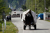 People pass the tense border crossing between Georgia and Abkhazia in the Georgian town of Zugdidi.  Georgia, a former Soviet country, waged a brutal war with Abkhazia during the breakup of the Soviet Union in the early 1990s, and was again at war with Russia in August 2008.