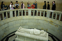 """Some visitors are looking at the funeral scultpure of the mausoleum of Dr Sun Yat Sen in Nanjing. The statue was realized by the french sculptor Paul Landowski. Sun Yat-Sen was founder of the guomindang, still considered as the """"father of the chinese nation"""". He was the first president of the first republic of china in 1912 after the revolution of 1911. But he soon dismissed under pressure of war lords and let the general Yuan Shikai becoming president three months after."""