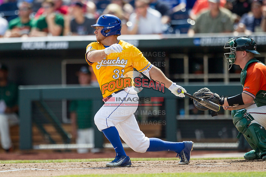 UC Santa Barbara Gauchos designated hitter Ryan Cumberland (31) follows through on his swing against the Miami Hurricanes in Game 5 of the NCAA College World Series on June 20, 2016 at TD Ameritrade Park in Omaha, Nebraska. UC Santa Barbara defeated Miami  5-3. (Andrew Woolley/Four Seam Images)