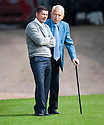 Morton Manager Allan Moore talks to chairman Douglas Rae before the game.