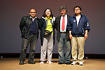 """Minamisanriku, Miyagi, Japan - (L to R) The Peruvian Felix Takeda, the Mexican Marcela Lamadrid and the Chilean Eduardo Ferrada, leaders of """"Todos con Japon"""" give donation to Mr. Chiba, the representative of Hayashi area at Minamisanriku, in order to purchase a fisherman boat, one year after the tsunami. The Latin group of volunteers """"Todos con Japon"""" visits Miyagi area during this Golden Week."""