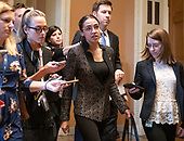 United States Representative Alexandria Ocasio-Cortez (Democrat of New York) is surrounded by reporters as she departs the US Senate Chamber after joining her US House Democratic colleagues in witnessing two votes on legislation to reopen the government in the US Capitol in Washington, DC on Thursday, January 24, 2019.  Both proposals were voted upon and both failed to get enough votes to pass.<br /> Credit: Ron Sachs / CNP