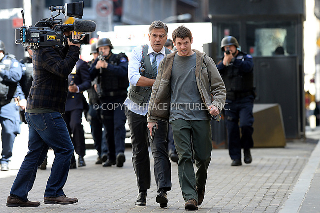 WWW.ACEPIXS.COM<br /> April 12, 2015 New York City<br /> <br /> George Clooney and Jack O' Connell on the film set of 'Money Monster' in the Financial District of Manhattan on April 12, 2015 in New York City. <br /> <br /> By Line: Kristin Callahan/ACE Pictures<br /> ACE Pictures, Inc.<br /> tel: 646 769 0430<br /> Email: info@acepixs.com<br /> www.acepixs.com