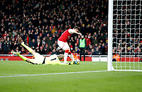 Jonas Lossl of Huddersfield Town dives despairingly as Olivier Giroud of Arsenal rounds him during the Premier League match between Arsenal and Huddersfield Town at the Emirates Stadium, London, England on 29 November 2017. Photo by Carlton Myrie / PRiME Media Images.