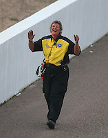 Feb 20, 2015; Chandler, AZ, USA; An NHRA member of the Safety Safari  during qualifying for the Carquest Nationals at Wild Horse Pass Motorsports Park. Mandatory Credit: Mark J. Rebilas-