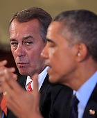The Speaker of the U.S. House John Boehner (Republican of Ohio), left, looks on as United States President Barack Obama makes a statement to the press pool as he meets with bipartisian congressional leadership in the Old Family Dining Room of the White House in Washington, D.C. on Friday, November 7, 2014. <br /> Credit: Dennis Brack / Pool via CNP
