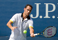 Michael Llodra (FRA) against Nicolas Kiefer (GER) in the First round. Kiefer beat Llodra 6-3 6-4 6-4..International Tennis - US Open - Day 3 Wed 02 Sep 2009 - USTA Billie Jean King National Tennis Center - Flushing - New York - USA ..© Frey, Advantage Media Network, Level 1, Barry House, 20-22 Worple Road, London, SW19 4DH +44 208 947 0100..