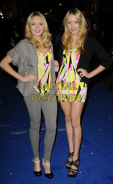 "SAMANDA - SAM & AMANDA MARCHANT.""Monsters vs Aliens"" UK film premiere - arrivals, Vue West End cinema, Leicester Square, London, England..March 11th, 2009.full length big brother twins samantha sisters grey gray jacket leggings eighties T-bar shoes black sandals strappy blazer patterned pattern print bright pink neon green yellow fluorescent matching dress mini body suit studded hands on hips .CAP/CAN.©Can Nguyen/Capital Pictures."