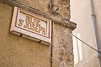Street sight on building, Sospel, France