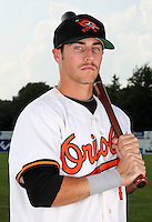 Aberdeen Ironbirds outfielder Trent Mummey (12) poses for a photo in a Baltimore Orioles uniform before a game vs. the Batavia Muckdogs at Dwyer Stadium in Batavia, New York;  August 11, 2010.   Batavia defeated Aberdeen 10-1.  Photo By Mike Janes/Four Seam Images