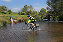 18/05/14<br /> <br /> A cyclist crosses a river near Tissington, in the Derbyshire Peak District.<br /> <br /> All Rights Reserved - F Stop Press.  www.fstoppress.com. Tel: +44 (0)1335 300098