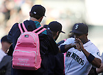 Seattle Mariners Endy Chavez (R)  jokes with the Mariners rookie pitchers as they head to the bull pen before their game against the Oakland Athletics September 13, 2014 at Safeco Field in Seattle.    <br /> The Athletics beat the Mariners 3-2 when Mariners pitcher Fernando Rodney  walked in Coco Crisp in the 10th inning.  &copy;2014. Jim Bryant Photo. All Rights Reserved.