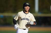 Christian Long (19) of the Wake Forest Demon Deacons rounds the bases after hitting his first career collegiate home run against the Gardner-Webb Runnin' Bulldogs at David F. Couch Ballpark on February 18, 2018 in  Winston-Salem, North Carolina.  The Demon Deacons defeated the Runnin' Bulldogs 8-4 in game one of a double-header.  (Brian Westerholt/Four Seam Images)