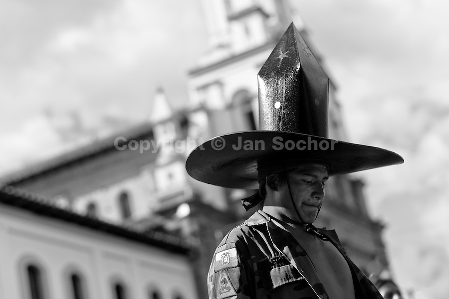 An Indian, wearing a large cardboard hat, performs during the Inti Raymi (San Juan) festivities in front of the church in Cotacachi, Ecuador, 24 June 2010. 'La toma de la Plaza' (Taking of the square) is an ancient ritual kept by Andean indigenous communities. From the early morning of the feast day, various groups of San Juan dancers from remote mountain villages dance in a slow trot towards the main square of Cotacachi. Reaching the plaza, Indians start to dance around. They pound in synchronized dance rhythm, shout loudly, whistle and wave whips, showing the strength and aggression. Dancers from either the upper communities (El Topo) or the lower communities (La Calera), joined in respective coalitions, seek to conquer and dominate the square and do not let their rivals enter. If not moderated by the police in time, the high tension between groups always ends up in violent clashes.