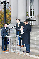 Men stand outside the NH State House with a small group of Trump supporters before Vice President Mike Pence leaves the New Hampshire Secretary of State's office in the New Hampshire State House in Concord, New Hampshire, on Thu., November 7, 2019. Pence traveled to New Hampshire as a surrogate for Donald Trump to file required paperwork for the president to get on the New Hampshire presidential primary ballot in 2020. The required documents include a filing form signed by the candidate and a $1000 filing fee.
