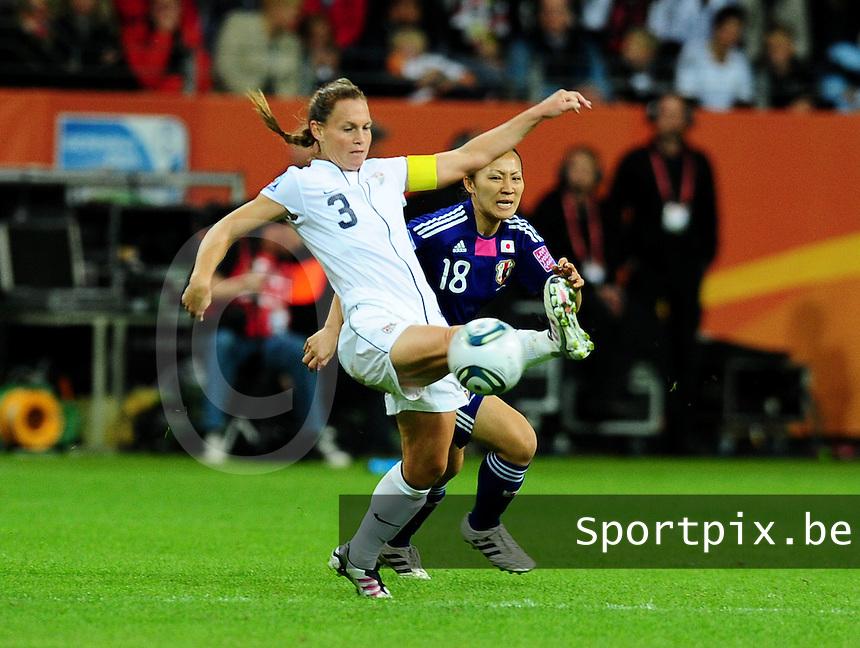 Fifa Women's World Cup Germany 2011 : Japan - USA  at Commerzbank Arena Frankfurt : Christie Rampone knalt de bal weg voor de ogen van Karina Maruyama.foto DAVID CATRY / Vrouwenteam.be